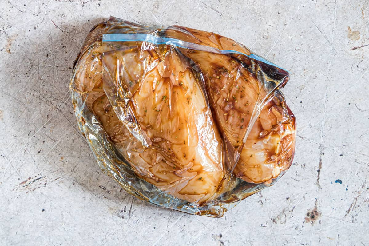 seasoned chicken in a plastic bag and ready to freeze