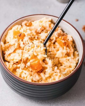 one bowl of instant pot pumpkin risotto served with a fork