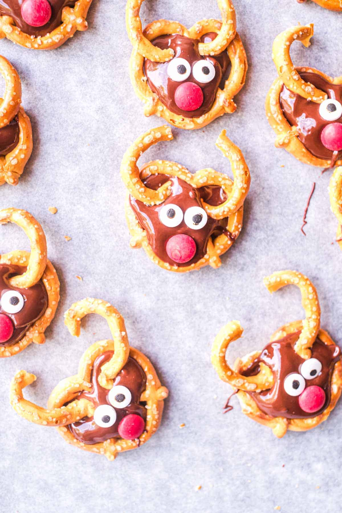 a table full of reindeer pretzels with red noses