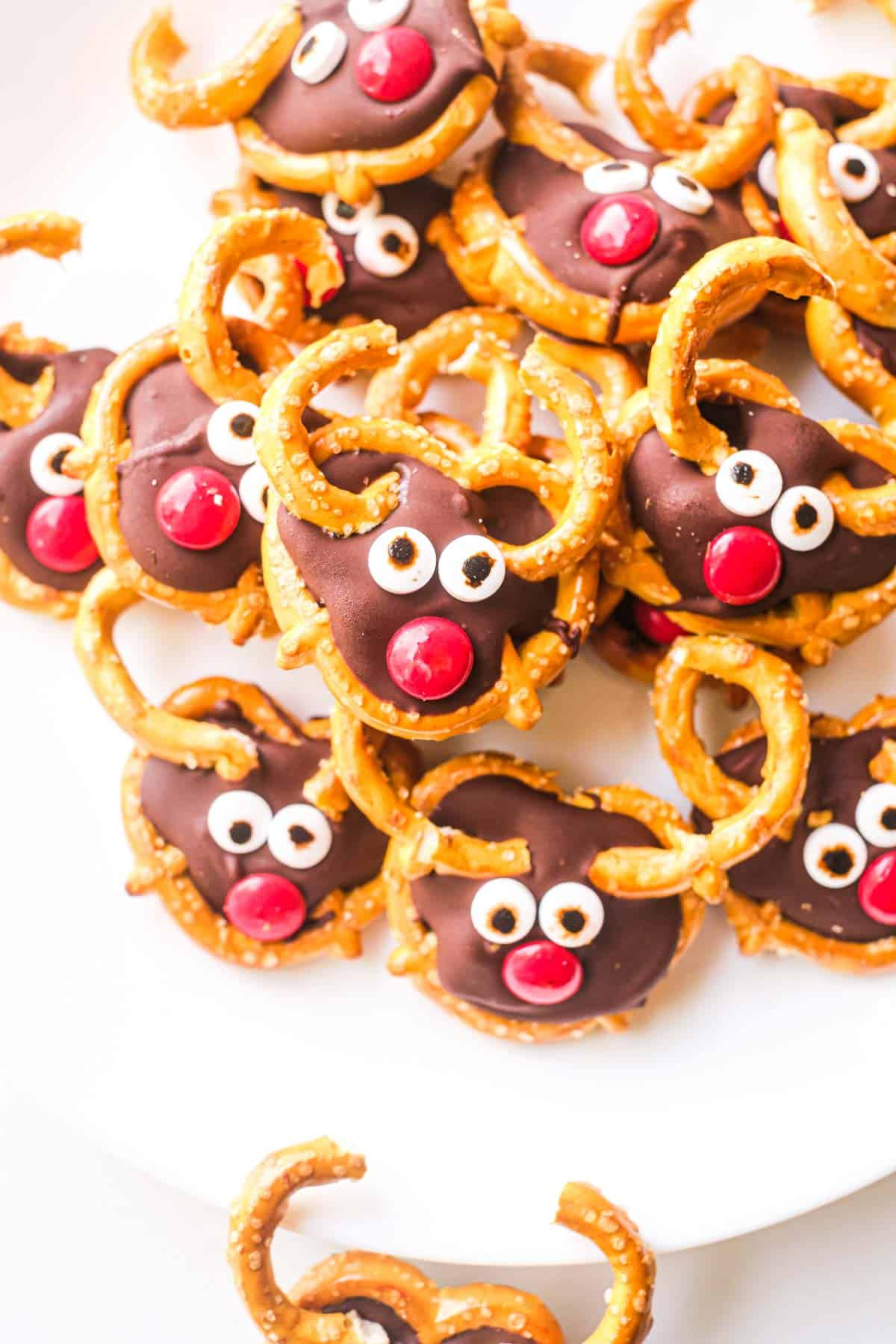 close up of a plateful of stacked pretzel reindeers