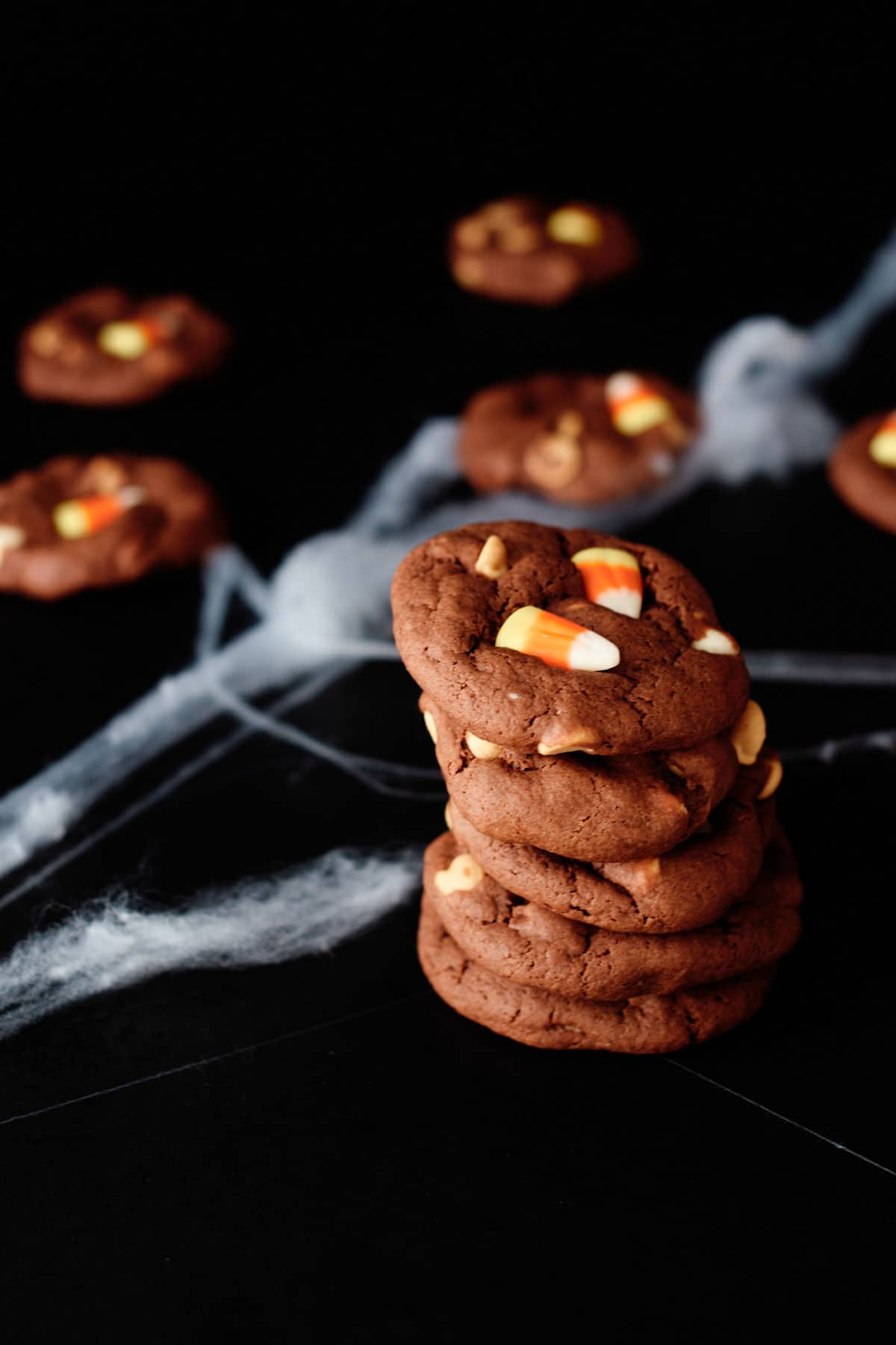 a stack of 5 candy corn cookies with another 5 set behind