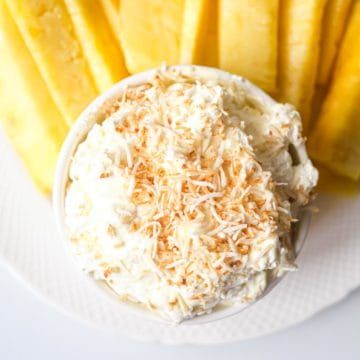 the finished pina colada cream cheese dip with pineapple spears