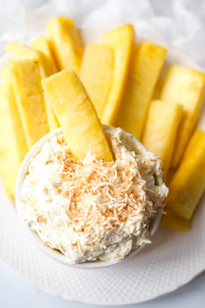 the completed cream cheese dip served with pineapple