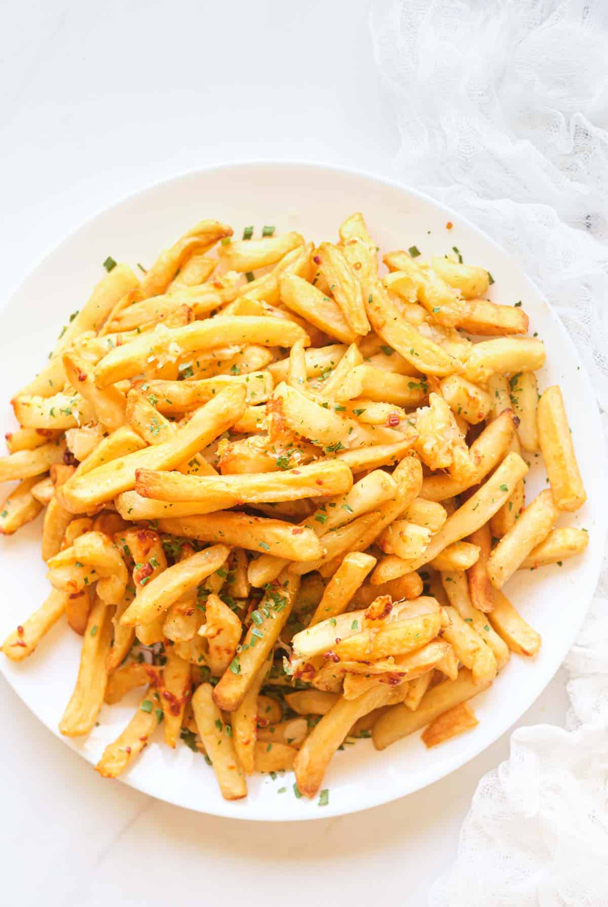 top down view of a plate filled with garlic parmesan fries