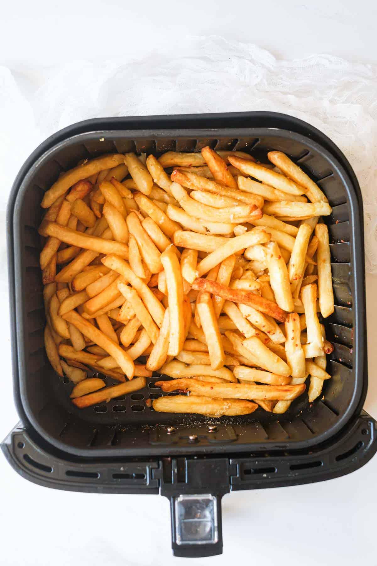 garlic parmesan fries inside the air fryer basket