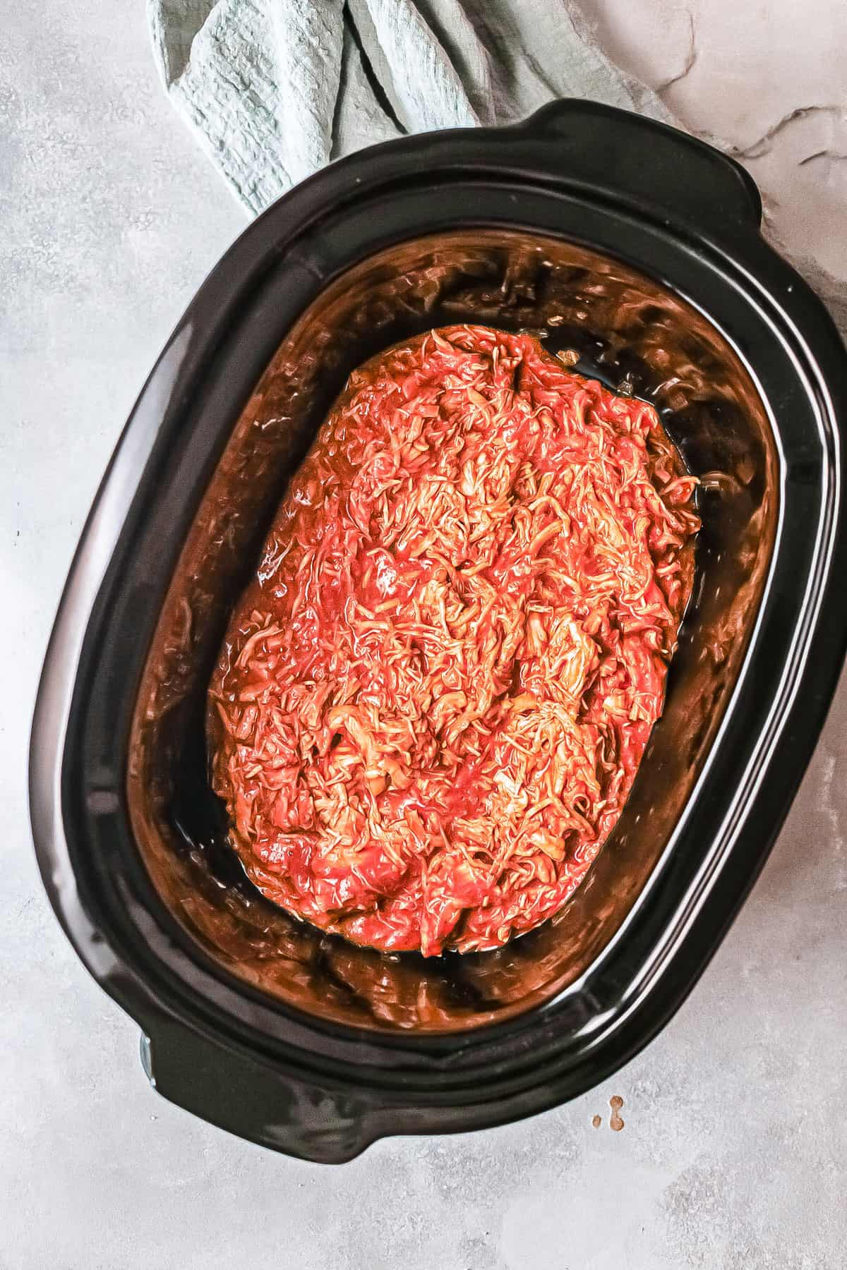 top down view of the slow cooker enchilada casserole inside the slow cooker