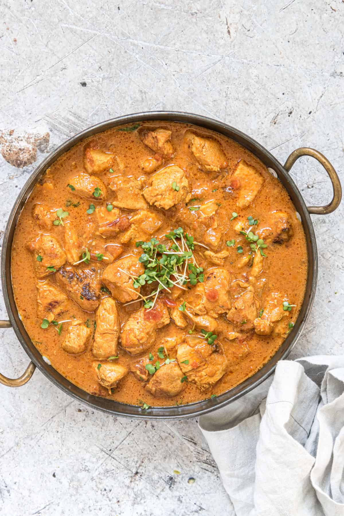 instant pot chicken curry served in a stainless steel dish