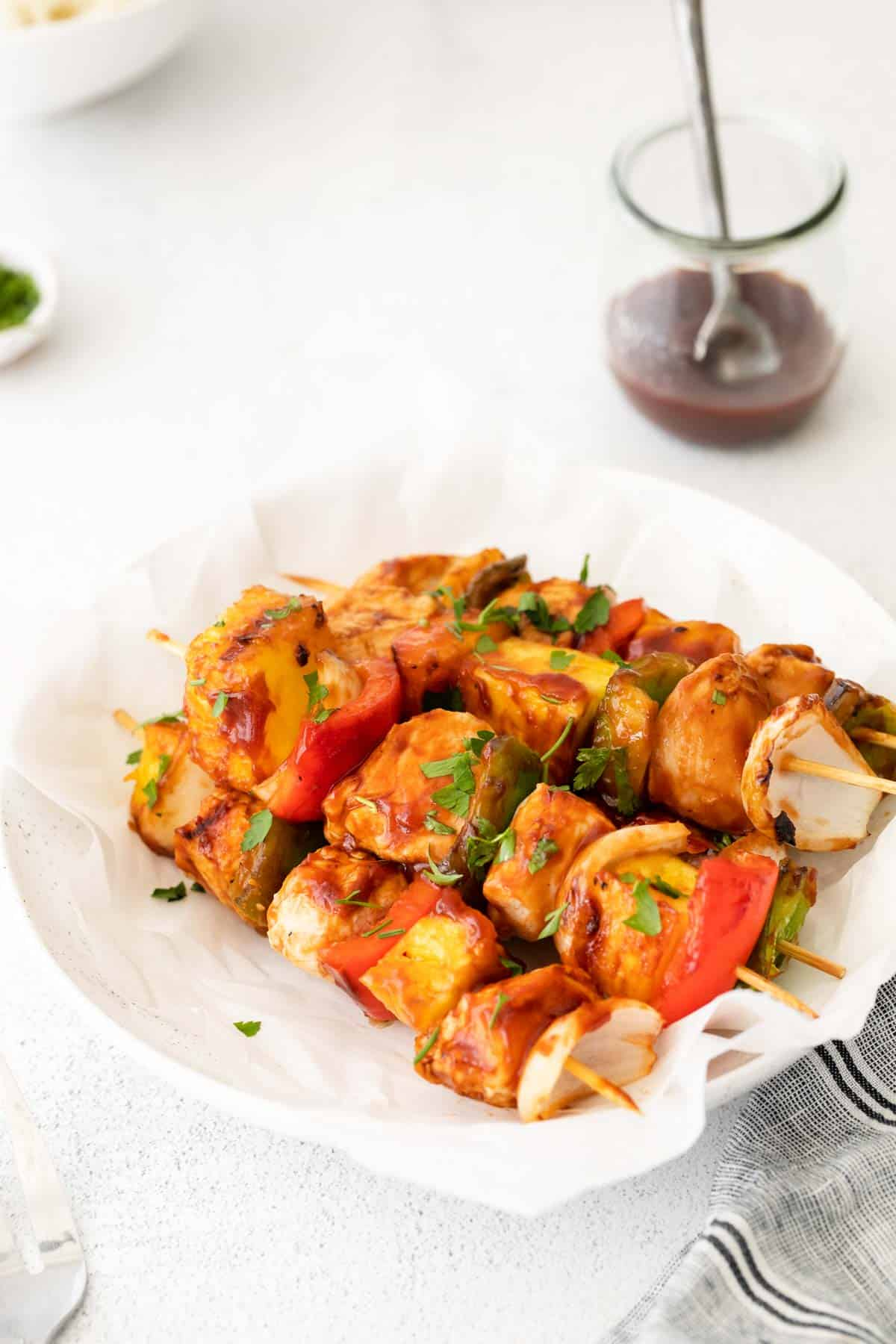 the cooked chicken kabobs served on a white plate
