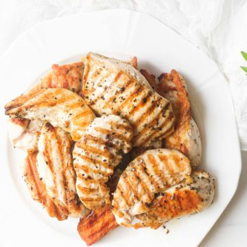 the finisherd grilled chicken strips served on a white plate
