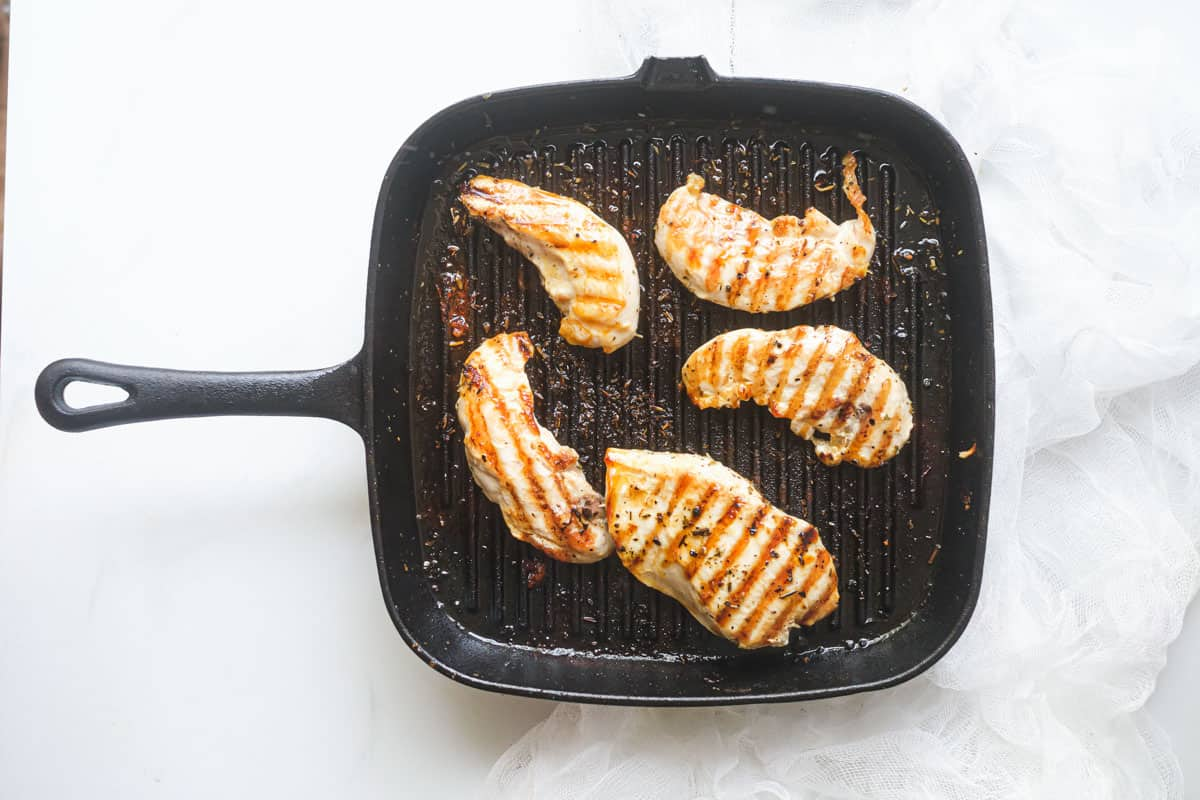 the finished grilled chicken tenders inside a grill pan