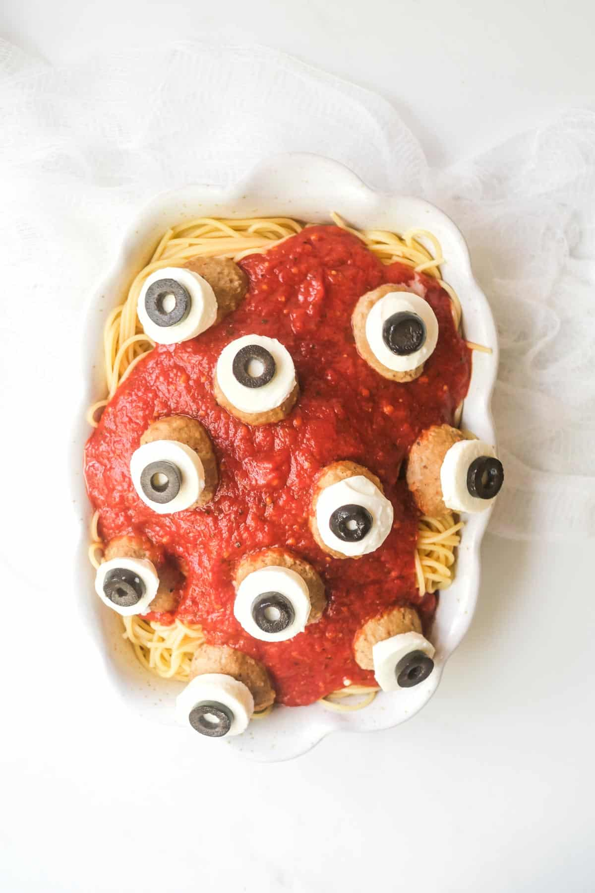 a serving platter filled with halloween spaghetti and meatballs