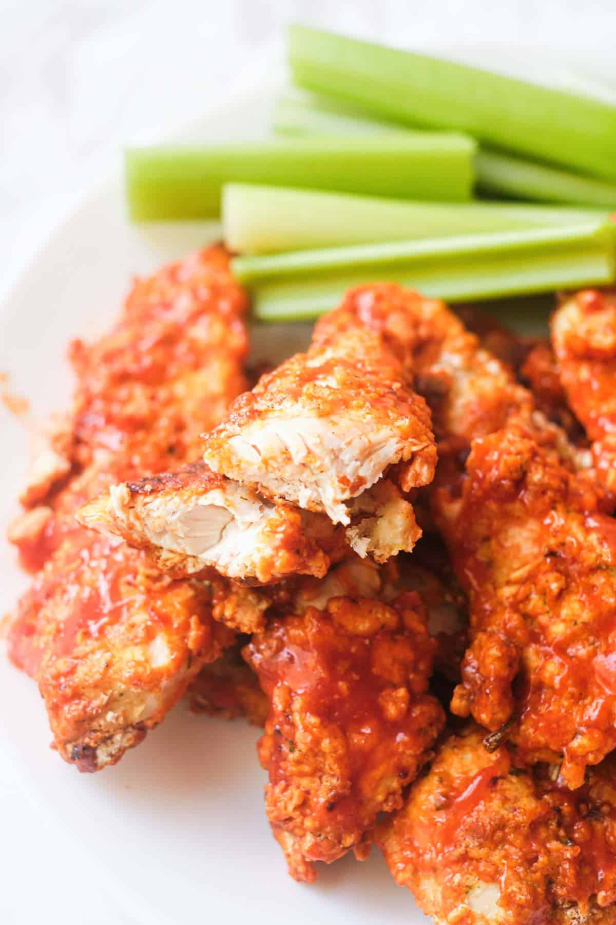 close up of a serving of buffalo chicken tenders