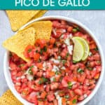 a bowl of pico de gallo garnished with tortilla chips and lime