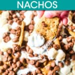 close up of s'mores nachos with a hand lifting a cracker