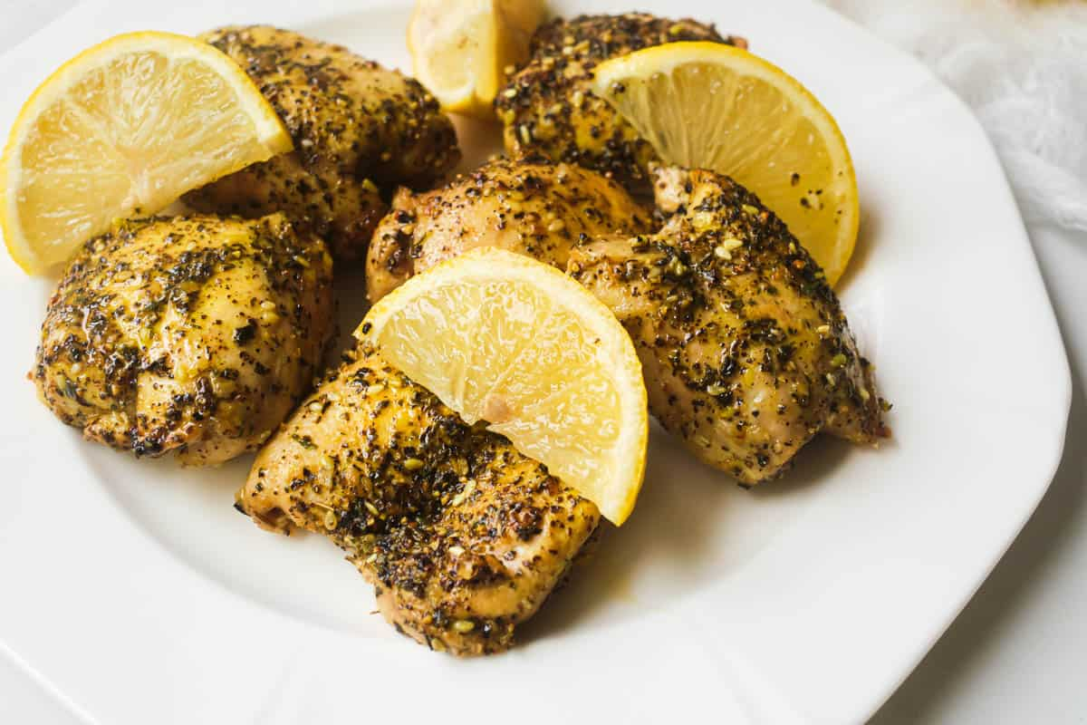 a plate filled with lemon pepper chicken thighs