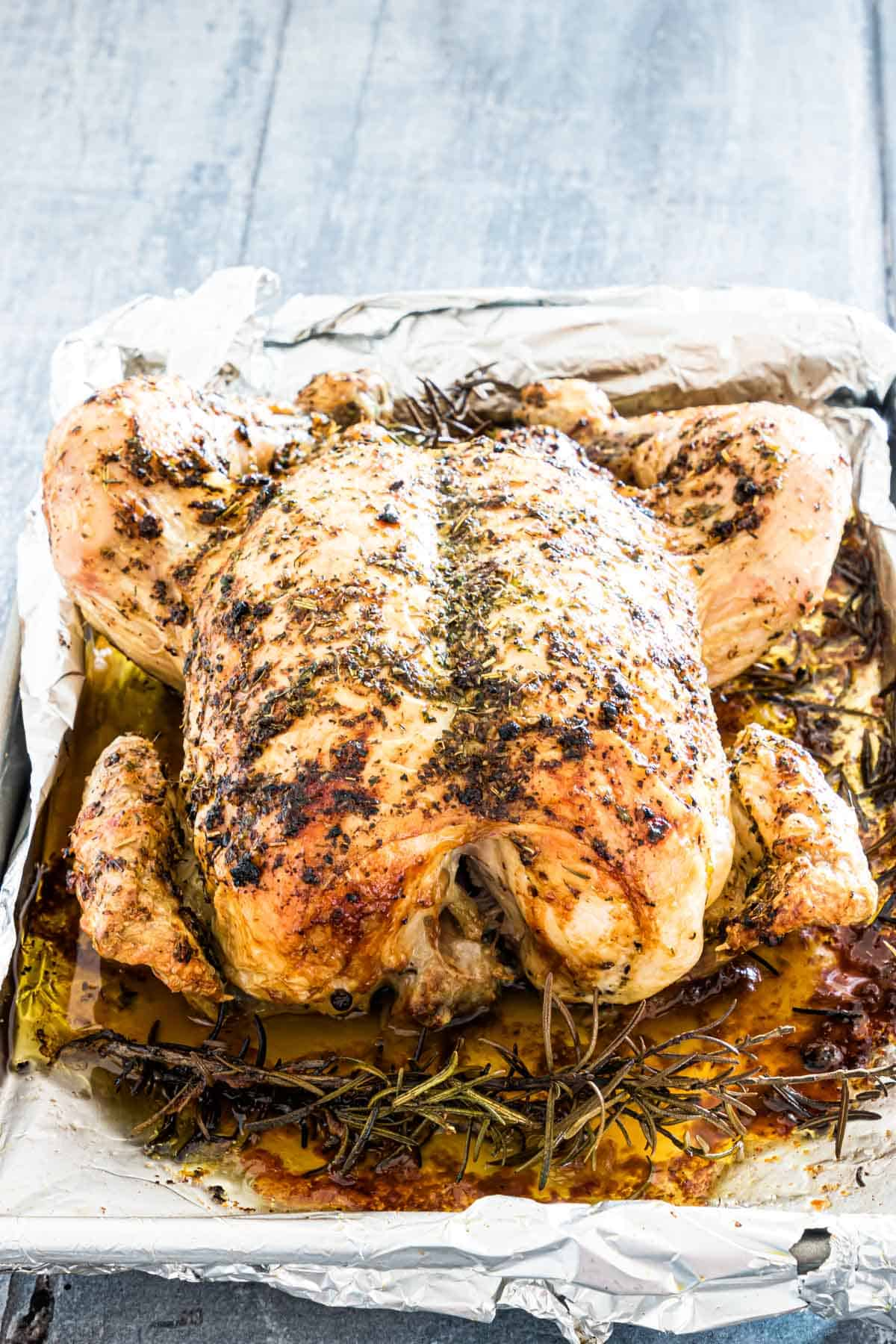 the completed roast chicken recipe on a baking tray and ready to be served