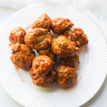 a plate of cooked buffalo chicken meatballs