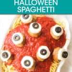 a bowl of spaghetti with tomato sauce and meatballs with cheese and olives to look like eyeballs
