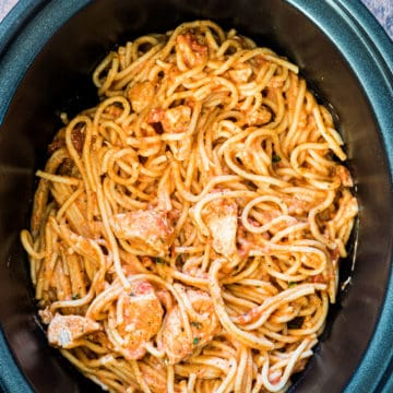 A crockpot full of slow cooker chicken spaghetti