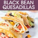 BLACK BEAN QUESADILLAS STACKED ON A PLATE